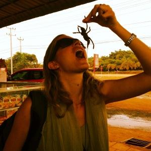 Brianne eating tarantula