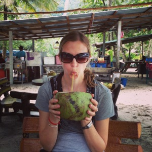 enjoying a coconut on Monkey Beach (Penang)